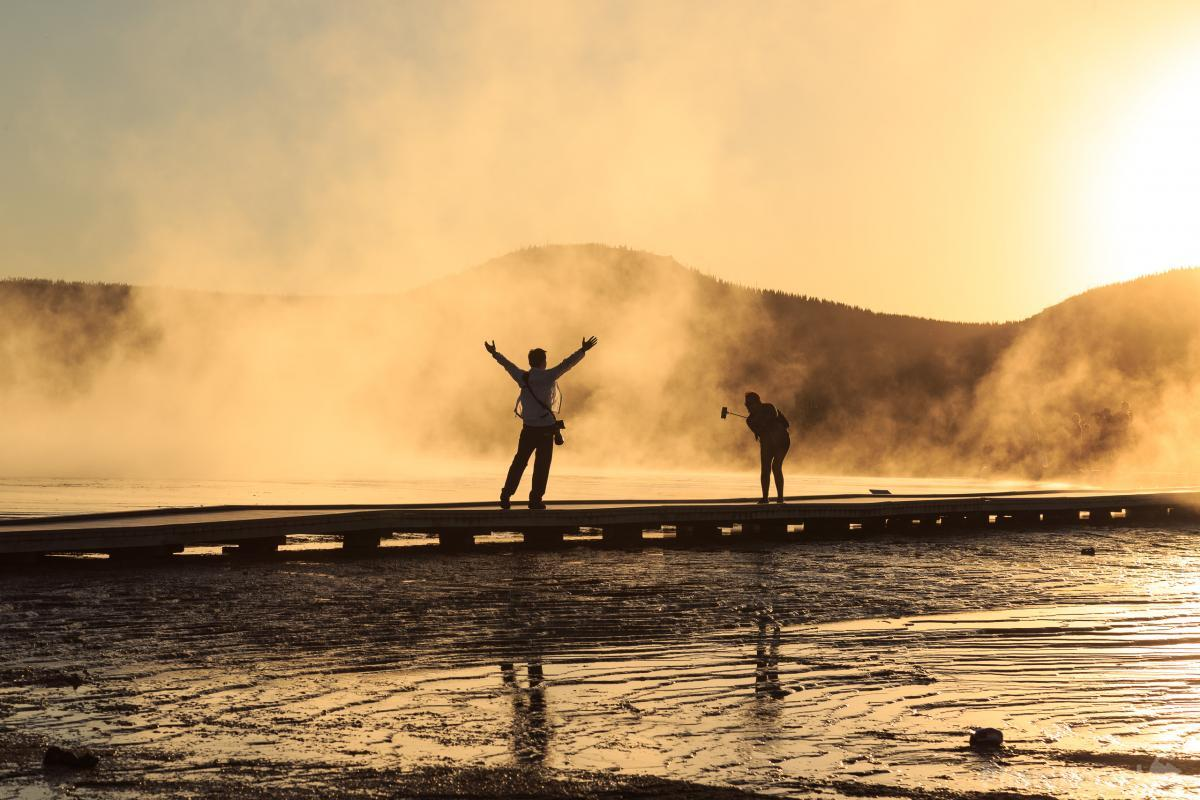 Tourists, Grand Prismatic Spring at sunset