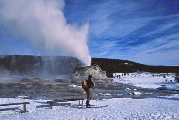 Skier and Castle Geyser