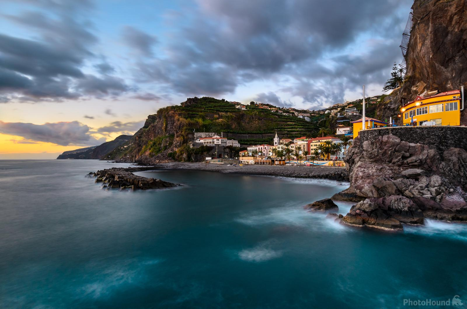 Ponta do Sol, taken with wider angle lens (16mm FF) and several images are blended to get the smooth water with some lights and the best sky from the sunset.
