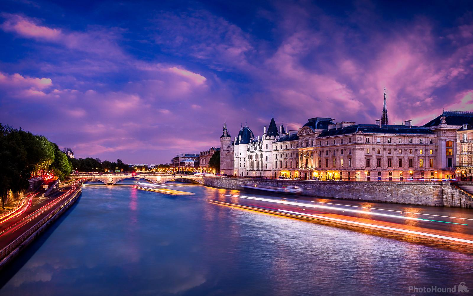Blue Hour on the Conciergerie and the Pont au Change at Paris view from the Pont Neuf, the old bridge of Paris. On the left, the lights are the cars on the Voie Georges Pompidou.