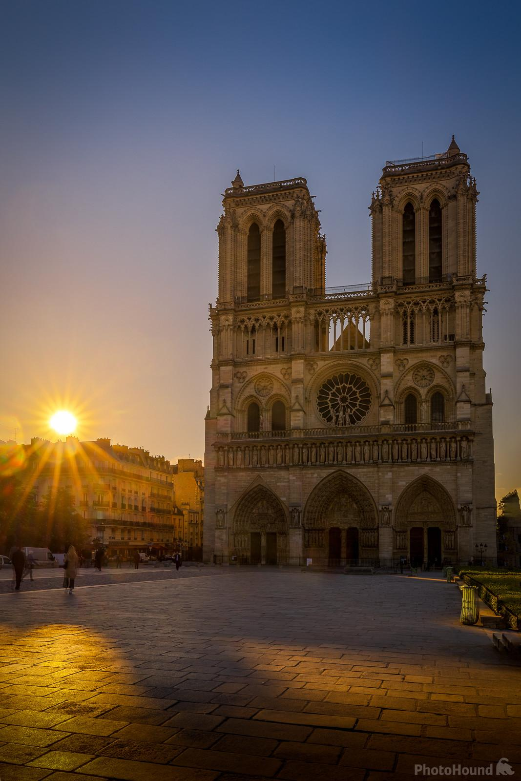 Sunrise on the cathedral Notre Dame de Paris seen from the Parvis Notre Dame - Place Jean-Paul II.